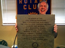 SUBMITTED PHOTO - Rotarian Craig Childress holds up the paver purchased by Peter and Cyndie Glazer to honor Rotarians who created and nurtured the lobster feed, which benefits many in the community, including Lakewood Center for the Arts.