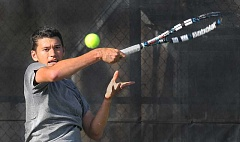 SETH GORDON - Junior Spencer Watanabe hits a forehand during his 6-4, 6-2 No. 1 singles victory over Lewis & Clark's Raed Attia Friday at the George Fox tennis courts. Watanabe unknowingly played the match with a partially torn ligament in his left shoulder.