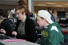 TIDINGS PHOTO: ANDREW KILSTROM - Athey Creek Middle School eighth-grader Grant Johnson, right, gets help from WLHS counselor Jennifer Jolly during freshman forecasting.