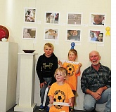 PHOTO BY BILL VOLLMER - Author Bing Bingham poses with young Ashwood students, near their photos.
