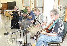 HOLLY GILL/MADRAS PIONEER - The Steve Fisher Band entertained at the Jefferson County Historical Society dinner.