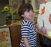 SUBMITTED PHOTOS  - Community Arts Preschool student Jack Beatty paints sunflowers at an easel.