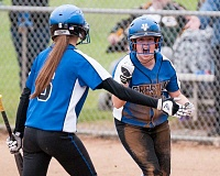 OUTLOOK PHOTO: JOSH KULLA - Gresham players celebrate scoring a run Wednesday in the Gophers' 4-2 softball win over rival Barlow High School.