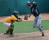 VERN UYETAKE - Lake Oswego's Jake Dukart dodges a tag to score a run for the Lakers in their 4-0 victory over West Linn on Monday to open up Three Rivers League play.