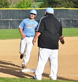 MATTHEW SHERMAN - Dutton Elske rounds third base and gets congratulated by coach Marco Tavera after hitting a solo home run that tied the game against Tigard on Monday.