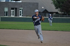 SETH GORDON - Lake Oswego's Jonas Lamont makes a throw to first base during the Lakers' victory over Newberg last week.
