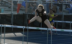 TIMES PHOTO: MATT SINGLEDECKER - Southridge junior Katja Berger won four events against Aloha including the 100-meter hurdles last week to help the Skyhawks take down the Warriors.