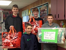 SUBMITTED PHOTO: ROSE MONEY - Four of the boys who made the clothing drive for Caring Closet such a success were, from the left, Carter Daniels, Caden Saefke, Jake Daniels and Jackson Saefke