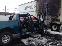 PHOTO BY BRYAN FOSTER - A truck in the parking lot of Nolan's Tire Factory spontaneously combusted.