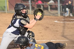 SPOKESMAN PHOTO: COREY BUCHANAN - Wilsonville catcher Katie Enbody tags Milwaukie's Justine Brown out at home.