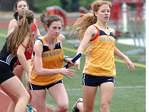 THE OUTLOOK: PARKER LEE - Barlows Kelsey Houston hands the baton off to Olivia Johnson on the way to a Bruins victory in the 4 x 800 relay Saturday.