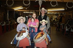 HOLLY SCHOLZ/CENTRAL OREGONIAN - Joe and Amy Fitzgerald took over the 40-year-old family business last October. WW Western Wear Tack and Trailer Sales is located on the Madras Highway in Prineville. They have three children, from left, Thomas, age 5, Josey, 1, and Larry, 3.
