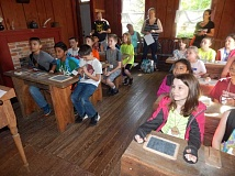 BARBARA SHERMAN - In the Butteville Schoolhouse, Deer Creek students sit at attention and follow the directions of Miss Ellen, which included standing up when called on and calling her 'Ma'am.'