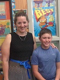 ESTACADA NEWS PHOTO: EMILY LINDSTRAND - Clackamas River Elementary School fourth-grade teacher Kari Hulsey was named Estacada's Teacher of the Year at the April 13 school board meeting. Here, she stands outside of her classroom with student Andrew Reidel.