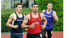 SETH GORDON - Sophomore Alex Canchola works to the outside to take the lead early on in the final event of the Northwest Conference decathlon, the 1,500 meters, en route to a dominating win in the race and overall.