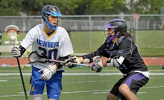 SETH GORDON - Midfielder Jay Byers shields a defender from the ball during Newberg's 9-8 overtime loss to visiting Hermiston Saturday.