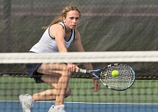 SETH GORDON - Ellen Pearson dips to hit a volley during her No. 3 singles match Saturday versus Pacific. Pearson fell 7-6 (7-4), 6-3 to Chantelle Baclay, but the Bruins won the match 6-3 Saturday.