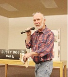 SUSN MATHENY/MADRAS PIONEER - Author Bing Bingham gives the background on a story before reading a selection aloud. At left, some 35 people enjoyed beverages, desserts and visiting with the author at the Rodriguez Annex April 16, prior to Bingham's talk.