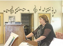 SUSN MATHENY/MADRAS PIONEER - Culver District's music teacher Sharon Gibson accompanies the high school band on piano during practice on April 13.