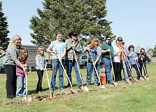HOLLY M. GILL - The family of the late Brandon Johnson, who died of a brain tumor last year at the age of 10, celebrated his life at the groundbreaking for a new splash pad at the Culver city park. From left, family members include Marie Crawford, Morgan, Renee and Jessica Johnson, Mike Crawford, Eva, Wayne and Marshal Johnson, project manager Craig Nicholson, Culver Councilor Bart Carpenter, Culver Mayor Nancy Diaz, and organizer Cindy Dix. The city will celebrate the completion of the project June 25.