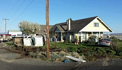 PHOTO COURTESY OF JCSO - Two vehicles collided and ended up in the yard of a residence at the corner of Northwest Columbia Drive and Northwest Ivy Lane on Monday morning, April 18.
