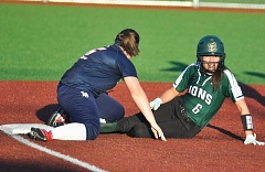 MATTHEW SHERMAN - Kaitlin Lampson slides safely in to third base during West Linn's home victory over Lake Oswego on Monday.