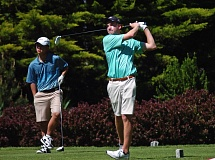 DAN BROOD - West Linn's Soren Carr watches a drive during Monday's league tournament. He shot a 72 to tie for medalist honors in the event.