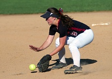 DAN BROOD - Tualatin junior second baseman Amanda Reser fields the ball during the Timberwolves' 4-0 win over Sherwood on Monday.