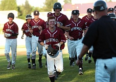DAN BROOD - Sherwood High School sophomore Bryce Vaughn (holding helmet) is all smiles after his walk-off single in Tuesday's game.