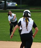 TRIBUNE PHOTO: JONATHAN HOUSE - Franklin High right fielder Christina Barrett tries to make the play at first base against Roosevelt. The first-place Quakers won Thursday's PIL softball game at Delta Park 11-1 in five innings to take a two-game lead on the Roughriders in the league standings.