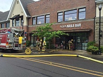 SUBMITTED PHOTO - Crews responded to a second alarm fire at Aqua Nails Bar in West Linn Central Village Friday morning. The fire was contained, but a cause and damage estimate have yet to be determined.