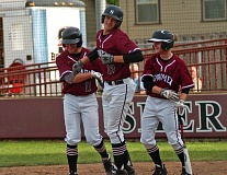 DAN BROOD - Sherwood junior Kevin Skurdahl (center) is congratulated by senior Brendon Wexted (left) and Bryce Vaughn after hitting a two-run home run in Thursday's game.