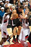 TRIBUNEPHOTO: JOSH KULLA - The Trail Blazers' Ed Davis (left) and Mason Plumlee (right) put the clamps on Los Angeles Clippers forward Blake Griffin.