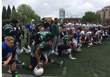 TRIBUNE PHOTO: STEVE BRANDON - Before Saturday's spring football game at Stott Community Field, the Portland State Vikings listen to speeches about the planned Viking Pavilion. PSU's ceremonial groundbreaking for the new arena took place before the football action.