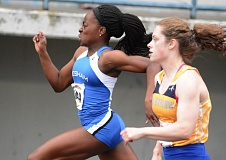 THE OUTLOOK: DAVID BALL - Gresham rookie Fechi Nmereole holds off Barlows Sara Turner midway through the 100-meter dash. Nmereole won the race coming through the line .03 hundredths in front.