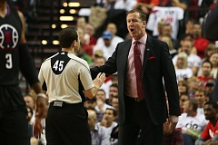 TRIBUNE PHOTO: DAVID BLAIR - Terry Stotts has a conversation with NBA official Brian Forte during Game 4 of the Trail Blazers first-round playoff series Monday night at Moda Center.