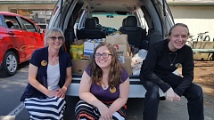 PHOTO COURTESY LESLIE ROBINETTE - Patrons of the Gladstone Library donated over 400 pounds of food to Gladstone Schools Backpack Buddies program, which serves 70 families each week. Pictured is the library's new director Linda Lewis (left) with employees Jennifer Ryder and Dillon Zoe.