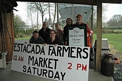 FILE PHOTO - The Estacada Farmers Market will return to its location outside of the Wade Creek House for a second year. Here, farmers market leaders stand with Wade Creek House owners Becky and Bill McFarland.