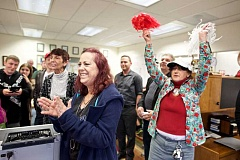 TIMES PHOTO: JAIME VALDEZ - Ruth Ann Myers of Yamhill, left, and Cathy Holtz, of Manzanita, cheer from presidential candidate Donald Trump's Tigard campaign office on Tuesday. Trump is hoping to draw big numbers during Oregon's closed primary on May 17.