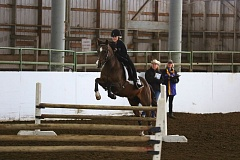 SUBMITTED PHOTO: STALNAKERS PHOTOGRAPHY - Annie Stamnes qualified for state in the hunt seat over fences event.