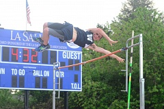 SPOKESMAN PHOTO: COREY BUCHANAN - Jake Estes finished third in the pole vault competition against La Salle.