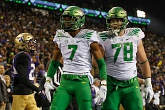 COURTESY: GODUCKS.COM - Lineman Cameron Hunt (right) and receiver Darren Carrington celebrate after an Oregon Ducks touchdown against Washington.