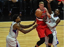 TRIBUNE PHOTO: MICHAEL WORKMAN - Mason Plumlee, Portland center, dishes off as he comes up against the Clippers' Jeff Green (right). Plumlee finished Game 5 Wednesday night with 10 points and a team-high 15 rebounds, plus four assists.