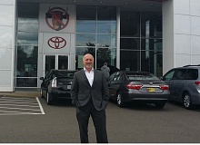 COURTESY WILSONVILLE TOYOTA - Wilsonville Toyota owner Dave Jachter outside his showroom after winning the President¹s Award from Toyota Motor Sales, U.S.A., Inc.
