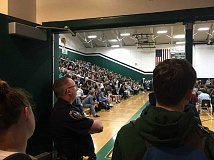 GEOFF PURSINGER - A Tigard police officer watches during an all-school assembly on Friday. Increased police presence was at the school following rumors of a possible school shooting.