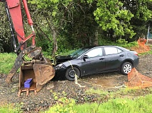CRAIG LOUGHRIDGE - A Toyota Corolla was crashed into a track hoe at the Bear Creek Byway construction site in Molalla only minutes after the car was stolen from a driveway on nearby Toliver Road.