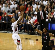TRIBUNE PHOTO: DAVID BLAIR - Trail Blazers guard Damian Lillard has plenty of space to launch a shot over Paul Pierce of the Los Angeles Clippers during Game 6 of their playoff series Friday night at Moda Center.