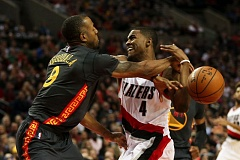 TRIBUNE FILE PHOTO: DAVID BLAIR - Trail Blazers forward Moe Harkless (right) has the ball poked away by Golden State's Andre Iguodala in a February game at Moda Center.