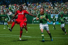 TRIBUNE PHOTO: JAIME VALDEZ - Toronto FC forward Jozy Altidore (left) controls a ball defended by the Portland Timbers' Nat Borchers during Sunday's MLS game at Providence Park.