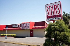 TIMES FILE PHOTO - Stars Cabaret & Steak House for years has staged adult entertainment from its Southwest Lombard Avenue location a block off Farmington Road, but it currently is facing legal challenges from two state agencies because minor girls allegedly were engaged in prostitution and nude dancing. An owner confirmed the Beaverton club is selling to a larger exotic dancing chain, Spearmint Rhino.